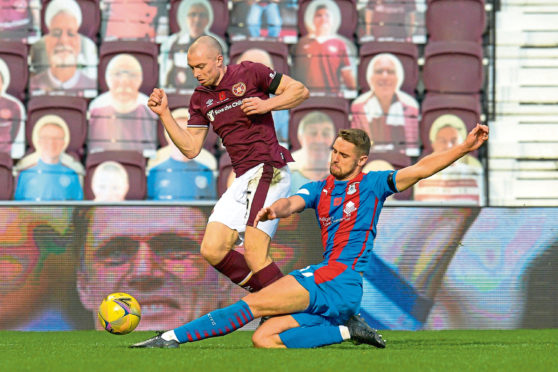 Robbie Deas putting in a challenge for Caley Thistle.