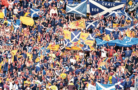 It has been a long wait for the Tartan Army, pictured at France 98.