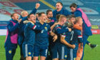 Scotland's players celebrate qualification for Euro 2020 in Belgrade.