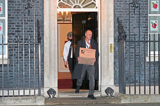 Prime Minister Boris Johnson's top aide Dominic Cummings leaves 10 Downing Street, London, with a box.