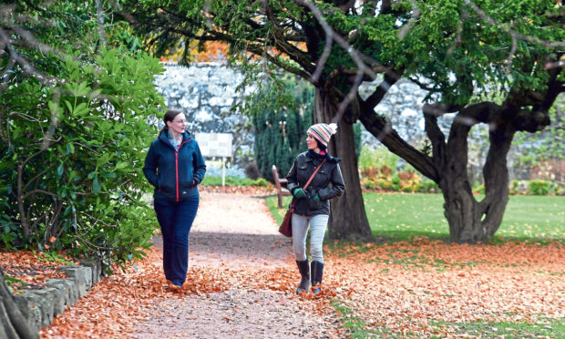 Gayle Ritchie walks through Ellon Castle Gardens with Dr Alison Craigon.