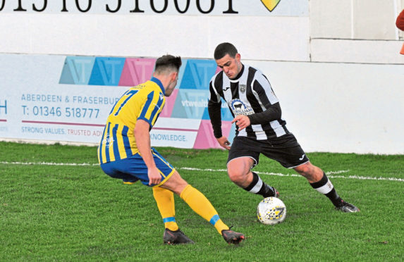Scott Barbour, of Fraserburgh, takes on Inverurie Locos' Thomas Reid in an Aberdenshire Cup clash last week. Picture by Paul Glendell