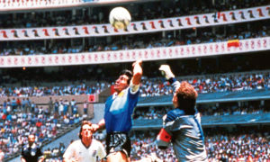 Diego Maradona scoring the 'Hand of God' goal at the 1986 Mexico world cup.