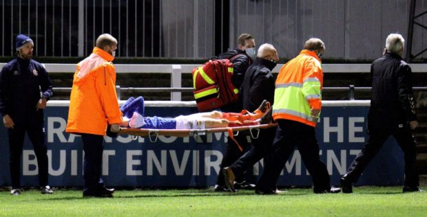 Ross Clarke is stretchered off during Elgin City v Cowdenbeath.