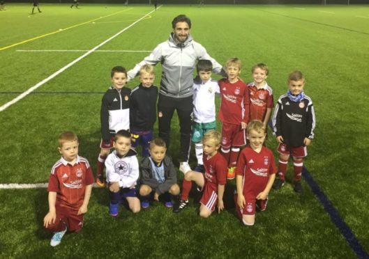 Graeme Shinnie returns to Dyce Boys Club where he started playing football.
