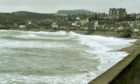 Flood barriers in use in Stonehaven earlier this year. Picture by Chris Sumner