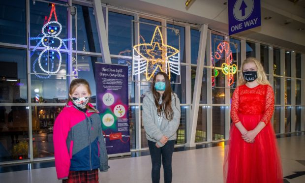 School pupils (L-R) Elli MacLean, Amy Fox and Kayleigh Paton.