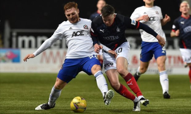 Fraser Fyvie (Cove Rangers) tussles with Anton Dowds (Falkirk) during the Scottish League 1 match.