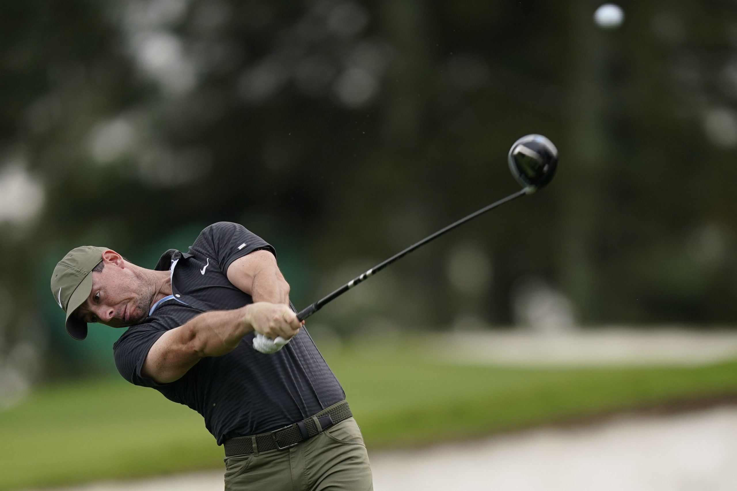 Rory McIlroy, of Northern Ireland, tees off on the third hole during a practice round for the Masters golf tournament Wednesday, Nov. 11, 2020, in Augusta, Ga.