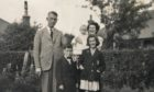 A Welsh library has uncovered a series of mystery photographs of the Walker family.