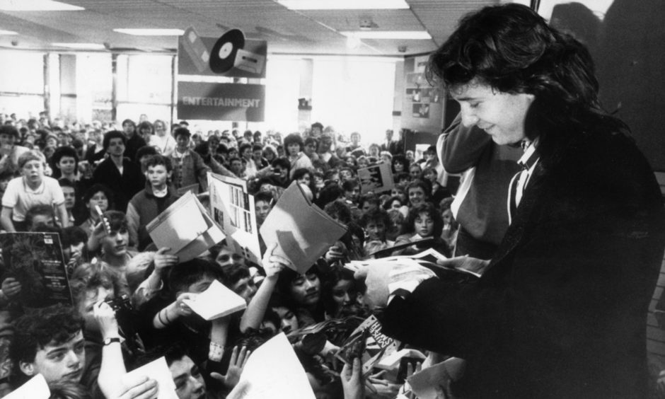 Simple Minds lead singer Jim Kerr was mobbed by fans when he paid a visit to Woolworths in Aberdeen for a record signing in 1987.
