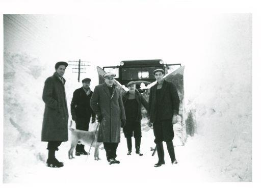 An image of men and a dog battling snow in Tomintoul has been included in the archive.