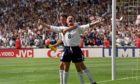 Paul Gascoigne celebrates with Teddy Sheringham in the Euro 96 clash against Scotland at Wembley.