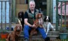 Robert Riggs pictured with his dogs, Angus, Duchess, Midge and Jez.