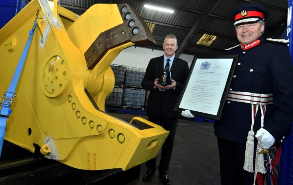 Hiretech CEO Andy Buchan receives the firm's Queen's Award from the Lord-Lieutenant for Aberdeenshire Sandy Manson.