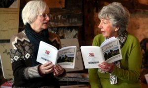 Director of Portsoy  Community Enterprise Anne McArthur, left  and Salmon Bothy volunteer Moira Smith with the new publication.