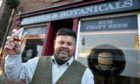 Mark Stephen, raises a toast to his new shop, Barrels and Botanicals in Main Street Turriff.