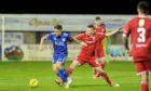 Peterhead midfielder Simon Ferry, left
