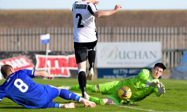 Lenny Wilson makes a save for Peterhead.  Picture by Kath Flannery