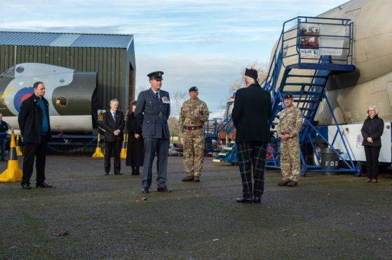 Moray military representatives paying their respects to the two pilots.