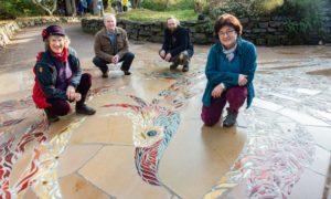 Leslie Downie (designer and artist) Stuart Voder (Stone Mason) Sebastian Freudenthal (Stonemason) and Marialaura Romagnoli (Assistant Art Director) unveiling the Phoenix mosaic.