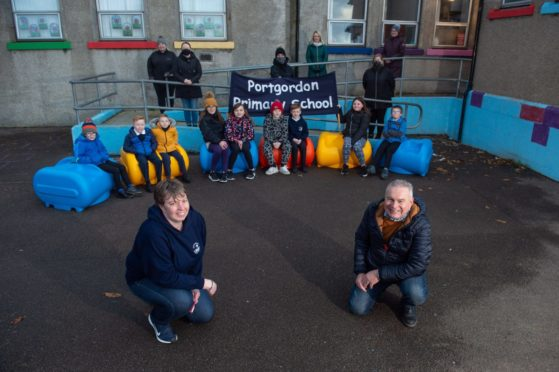 Portgordon Primary head teacher Karen Murray and Kenny Gunn (Chairman of Portgordon Fireworks Group) with the new outdoor seating.