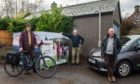 L-R: Gordon McAlpine, Manager Moray Carshare, resident William Malcolm and councillor Derek Ross unveil the new biking and car services in Aberlour.
