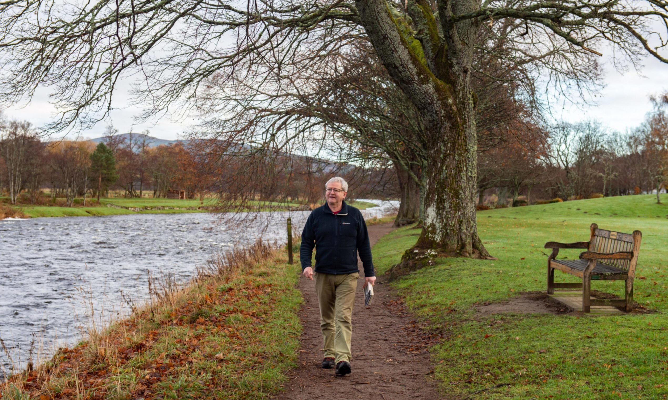 Dr William K Malcolm walks along the banks of the River Spey near his Aberlour home.