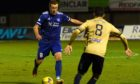 Scott Brown running with the ball for Peterhead. Picture by Kenny Elrick