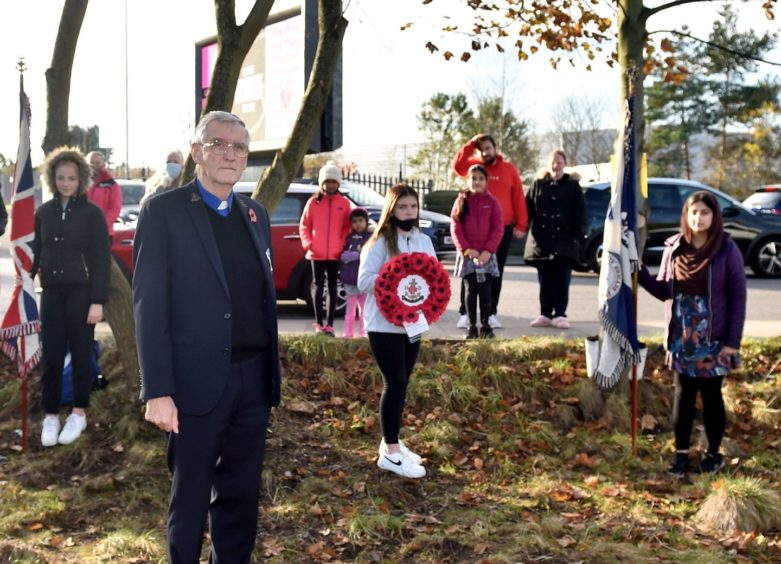 Minister Andy Cowie of the Kittybrewster Congregational Church with his company holding their own act of remembrance.