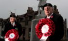 Branch president David Taylor,left, and chairman Douglas Watson, laying a wreath at Ellon's war memorial earlier this month. Picture by Scott Baxter