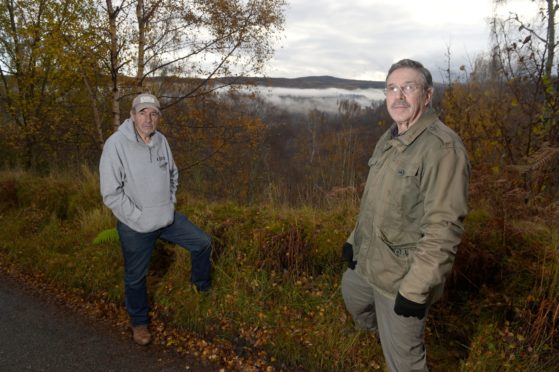 Local concerns over another planned windfarm n the hills above Tomich and Glen Affric.   Objectors Peter Small and Angus Brumhead with the proposed site beyond. Picture by Sandy McCook