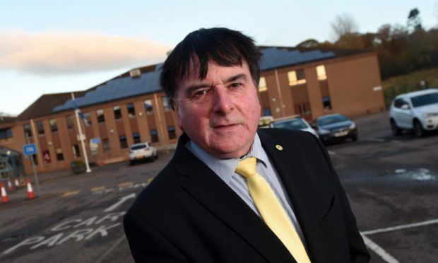 Highland Councillor Ken Gowans outside Culloden Academy.