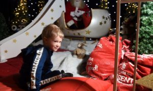 With Santa is three-year-old Archie Rourke of Aviemore.