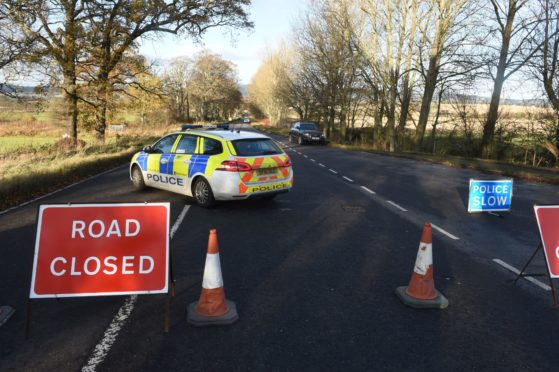 Police at the scene of the accident in Invergordon this morning.