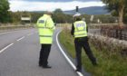Police at the scene of an accident on the A82