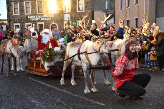 A previous Santa and reindeer parade through Banff.