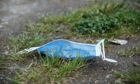 To go with story by Calum Petrie. The James Hutton Institute is responding to concerns over the ecological impact of Covid-19 by developing environmentally-friendly PPE. Picture shows; Discarded face mask. Aberdeen. Supplied by James Hutton Institute Date; Unknown