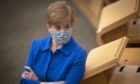 First Minister Nicola Sturgeon in the main chamber before First Minister's Questions at the Scottish Parliament in Edinburgh