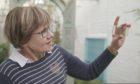 Christine Strullu-Derrien examining a slide containing the Rhynie chert rock.