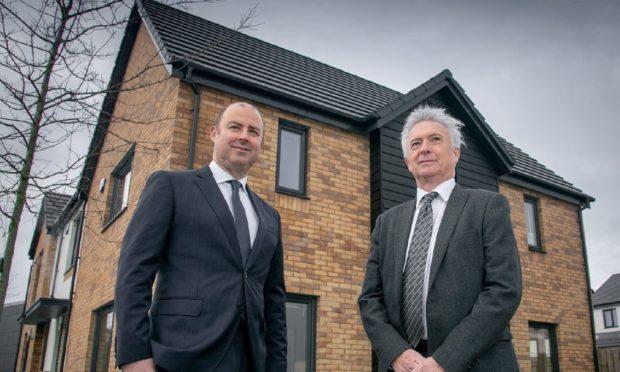 Stewart Milne Group chief executive Stuart MacGregor with his predecessor Glenn Allison.