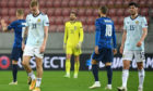 Scotland's Oli McBurnie, goalkeeper Craig Gordon and Scott McKenna appear dejected after the final whistle during the UEFA Nations League Group 2, League B match at City Arena, Trnava, Slovakia.