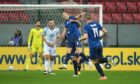 Slovakia's Jan Gregus (centre) celebrates scoring his side's first goal of the game with team-mates.