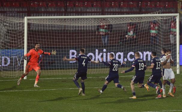 Scotland's David Marshall celebrates saving from Serbia's Aleksandar Mitrovic to win the penalty shootout.