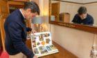 Simon West looks through his career memorabilia.