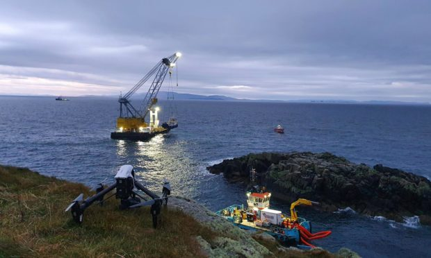 The recovery operation of the sunken fish farm vessel Tiffany of Melfort at Shiant Isles.