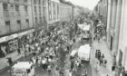 Out in force...Aberdeen's Union Street is packed with people for the last shopping Sunday before Christmas in 1987.