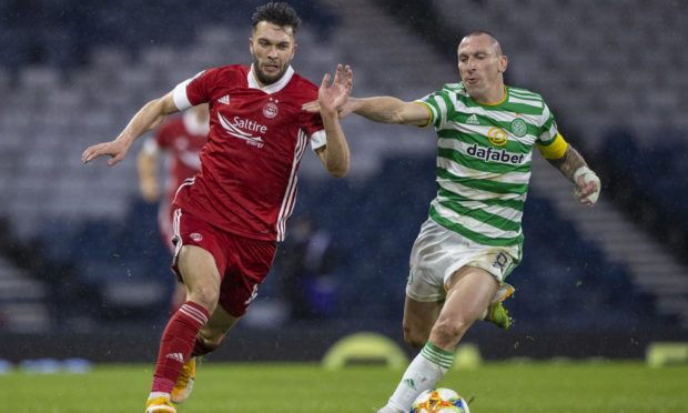 Aberdeen's Conor McLennan (left) tries to get away from Scott Brown of Celtic.
