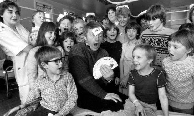 Paul Daniels worked his magic for kids of all ages with his tricks at Royal  Aberdeen Children's Hospital in 1984. He visited the hospital while at His Majestys with his one-man magic show.