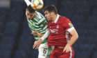 Tommie Hoban, right, competes with Celtic's Nir Bitton for a header in the 2019/20 Scottish Cup semi-final at Hampden.